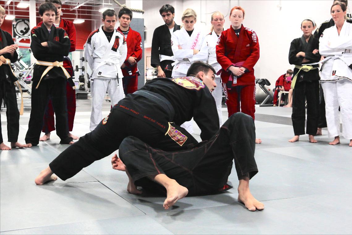 Instructor performing a demo in Brazilian Jiu Jitsu Fundamentals class
